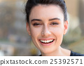 close up of woman laughing  25392571