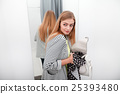 Woman stealing a dress 25393480