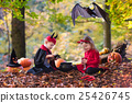 Kids on Halloween trick or treat 25426745