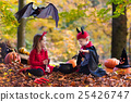 Kids on Halloween trick or treat 25426747