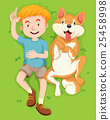 Boy and pet dog lying on grass 25458998