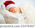 sleeper newborn baby in  Christmas Santa cap 25476407