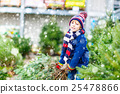 beautiful smiling little boy holding christmas 25478866