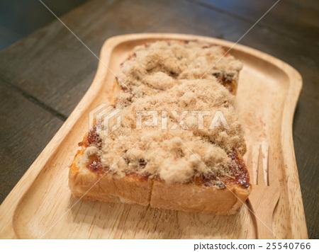 shredded dried pork toast on wood tray 25540766