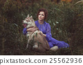Girl hugging dog. 25562936