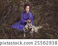 Girl and dog in grass. 25562938