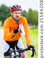 Cyclist on race bike pedaling on bike track 25564208