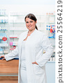 Pharmacist in chemist shop looking at camera 25564219