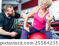 senior woman working out with dumbbells  25564235