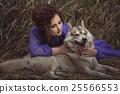 Woman said to the dog's ear. 25566553