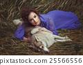 Girl lies on a dead dog. 25566556