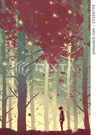 man standing in forest with falling leaves 25568743