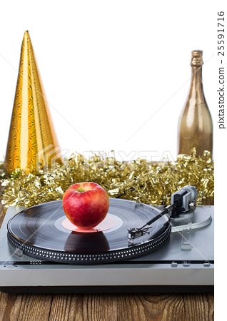 Stock Photo: Shiny party hat with record player and apple