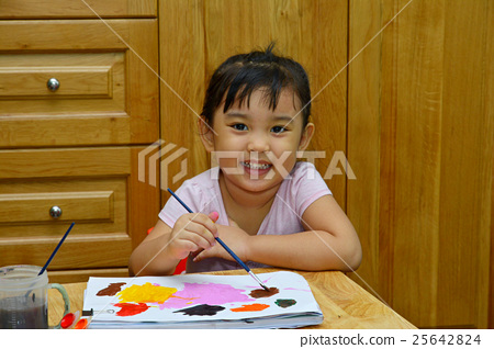 A cute young asian girl painting a picture 25642824