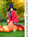 Little girl wearing halloween costume on a pumpkin patch 25649407