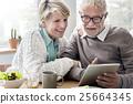 Senior Adult Holding Tablet Reading Concept 25664345