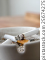 Cigarettes in an ashtray 25674275