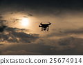 Flying drone with camera on the sky at sunset 25674914