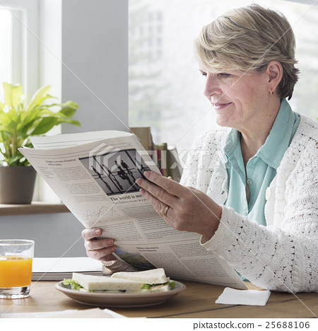 Senior Adult Reading Newspaper Concept 25688106