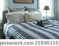 bedroom with pillows and decorative accordion 25690150
