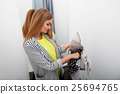 Woman stealing a dress 25694765