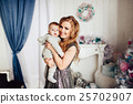Christmas tree and happy mother with son 25702907