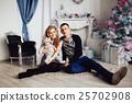 Christmas tree and happy family around 25702908