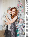 Christmas tree and happy mother with son 25702909