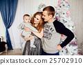 Christmas tree and happy family around 25702910