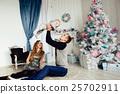 Christmas tree and happy family around 25702911