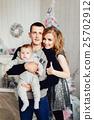 Christmas tree and happy family around 25702912