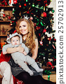 Christmas tree and happy mother with son 25702913