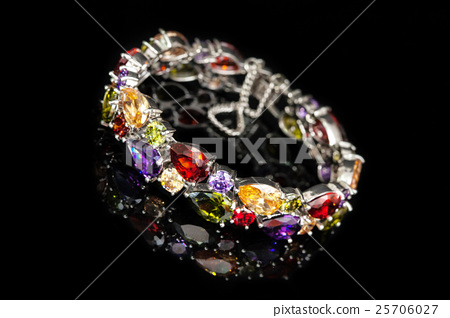 Bracelet with colorful stones isolated on black 25706027