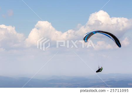 Skydiving  extreme over the mountains 25711095