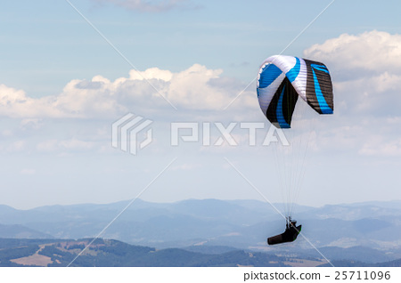 Skydiving  extreme over the mountains 25711096