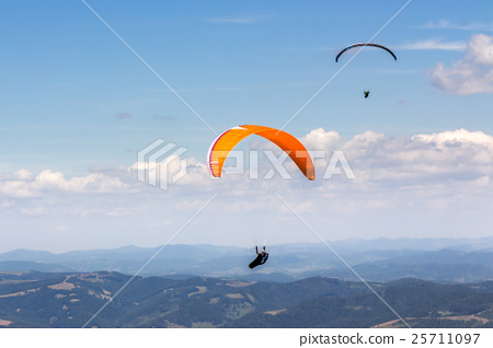 Skydiving  extreme over the mountains 25711097