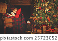 little child girl sleeping near a Christmas tree 25723052