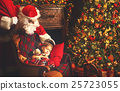 Santa Claus came to sleeping child girl in Christmas 25723055