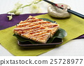 Real firmer okonomiyaki on green leaf and bl 25728977