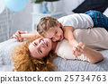 Happy little girl having fun with her grandmother 25734763