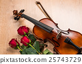 Violin, rose and music books 25743729