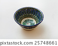 one typical central asian bowl on white plaster 25748661