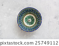 traditional central asian bowl on concrete plate 25749112