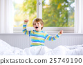 Adorable happy little kid boy after sleeping in 25749190