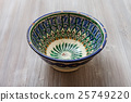 traditional central asian bowl on gray brown board 25749220