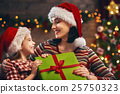 Mother and daughter exchanging gifts 25750323