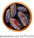 Dried Medjool dates from Morocco in wooden bowl 25751323
