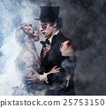 Dressed in wedding clothes romantic zombie couple 25753150