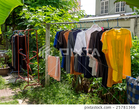 Thai style drying their washed clothes outside 25781366