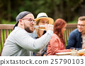 man drinking beer with friends at summer party 25790103